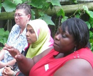 Lottie speaking at an All Our Kin Garden Project workshop