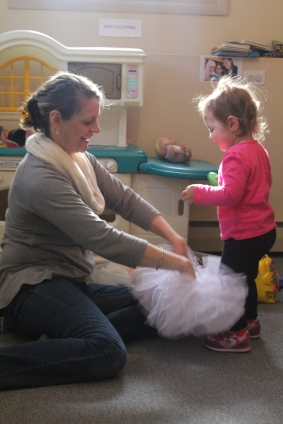 Patti helps Grace climb into a tutu