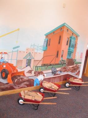 mural + wheelbarrows