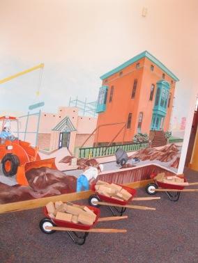 mural + wheelbarrows