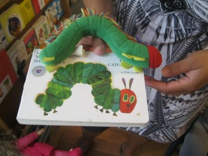 Melissa uses props -- like this stuffed caterpillar -- to make reading more interactive.