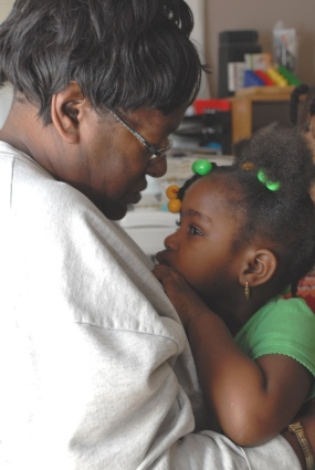 One of our favorite photos of Ms. Fain with a child in her family child care program