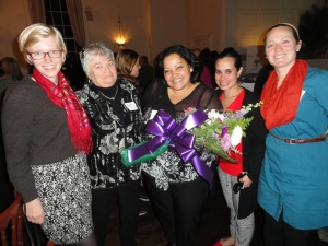 Nilda Aponte, center, surrounded by All Our Kin staff members.