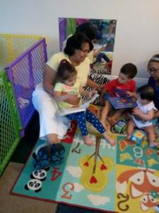 Argentina (left) and her assistant (right) engage children in an early literacy activity